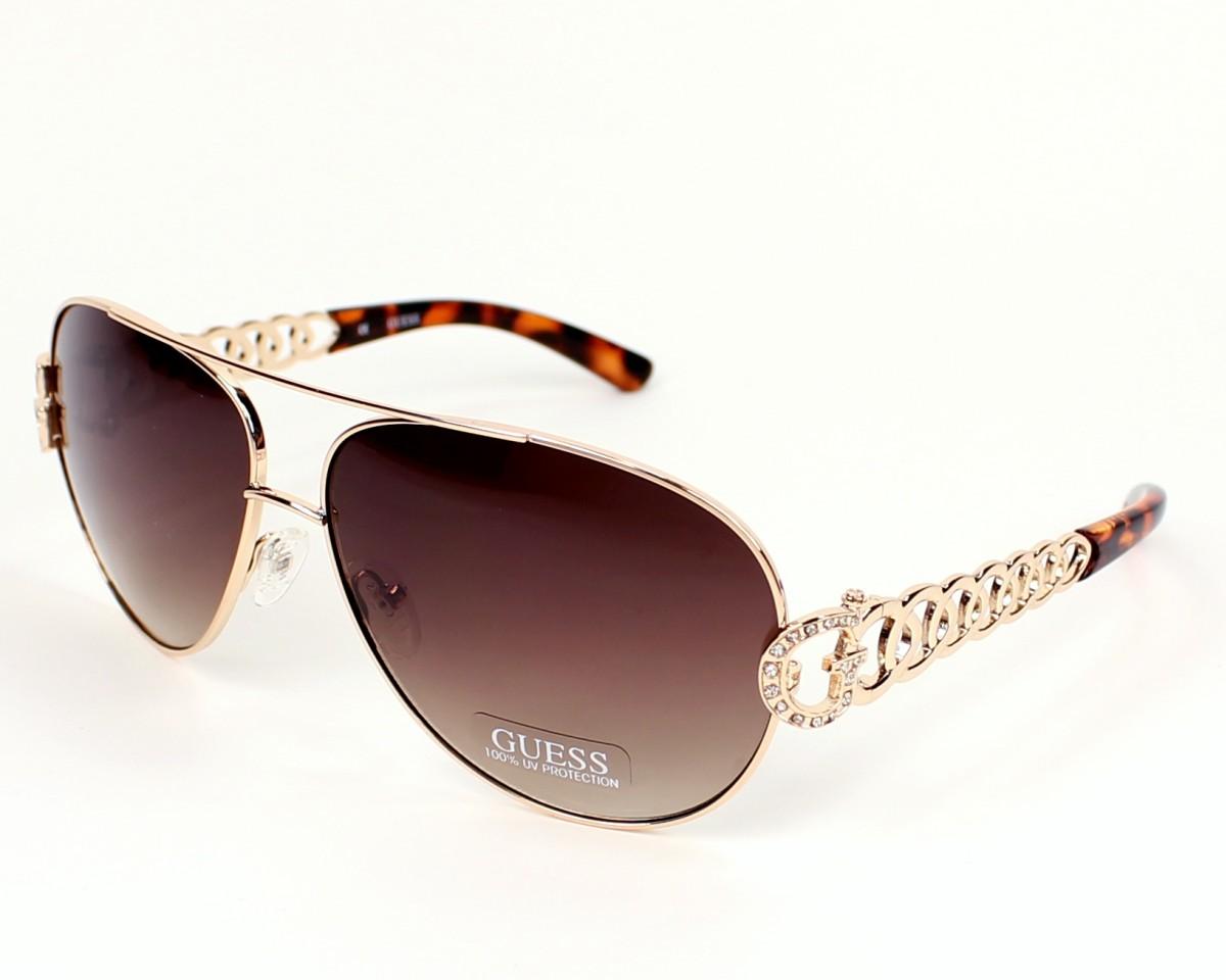 e16d8fa813 Gafas de sol Guess GU-7299 GLD-34 - Oro vista de perfil